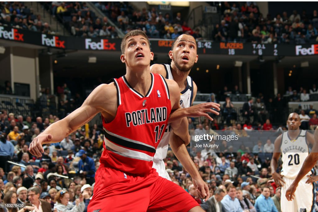 Meyers Leonard #11 of the Portland Trail Blazers rebounds against Tayshaun Prince #21 of the Memphis Grizzlies on March 6, 2013 at FedExForum in Memphis, Tennessee.