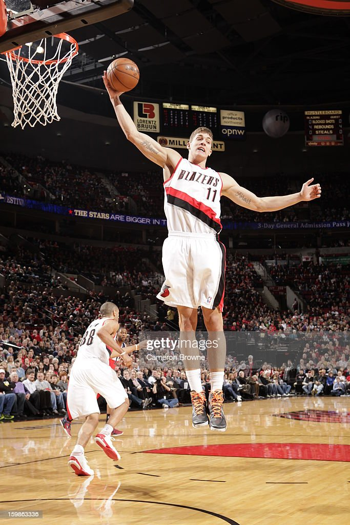 Meyers Leonard #11 of the Portland Trail Blazers rebounds against the Washington Wizards on January 21, 2013 at the Rose Garden Arena in Portland, Oregon.