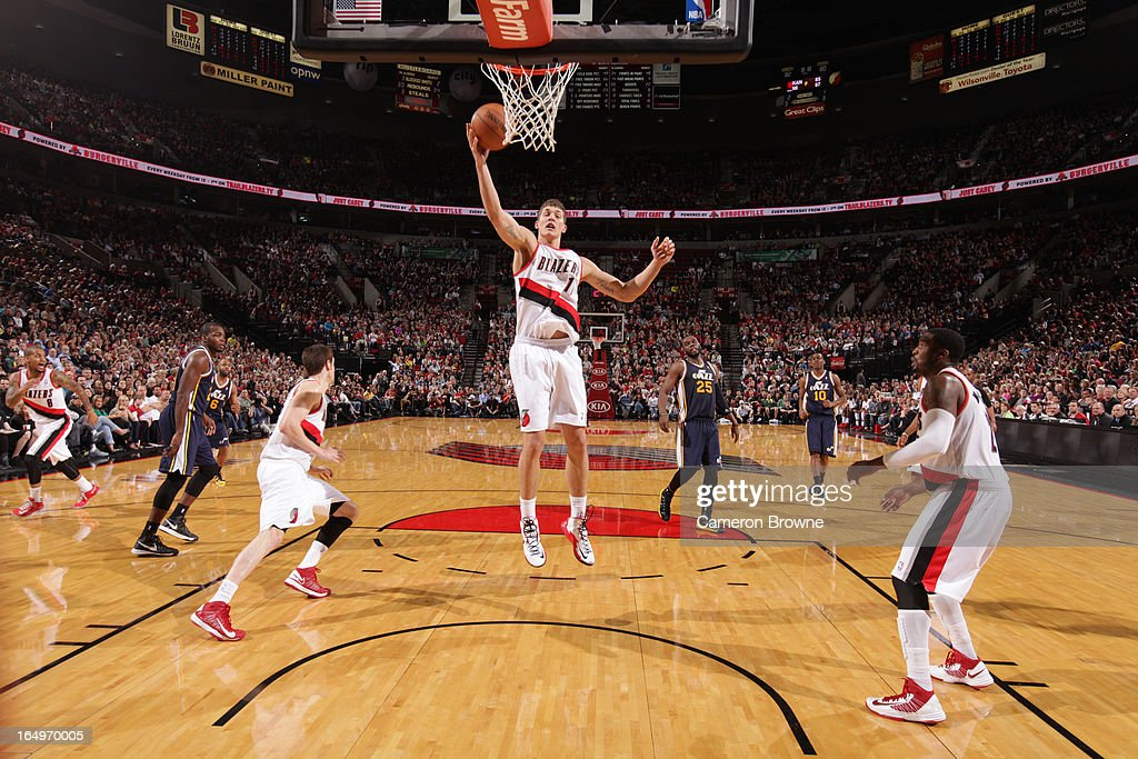 <a gi-track='captionPersonalityLinkClicked' href=/galleries/search?phrase=Meyers+Leonard&family=editorial&specificpeople=6893999 ng-click='$event.stopPropagation()'>Meyers Leonard</a> #11 of the Portland Trail Blazers rebounds against the Utah Jazz on March 29, 2013 at the Rose Garden Arena in Portland, Oregon.