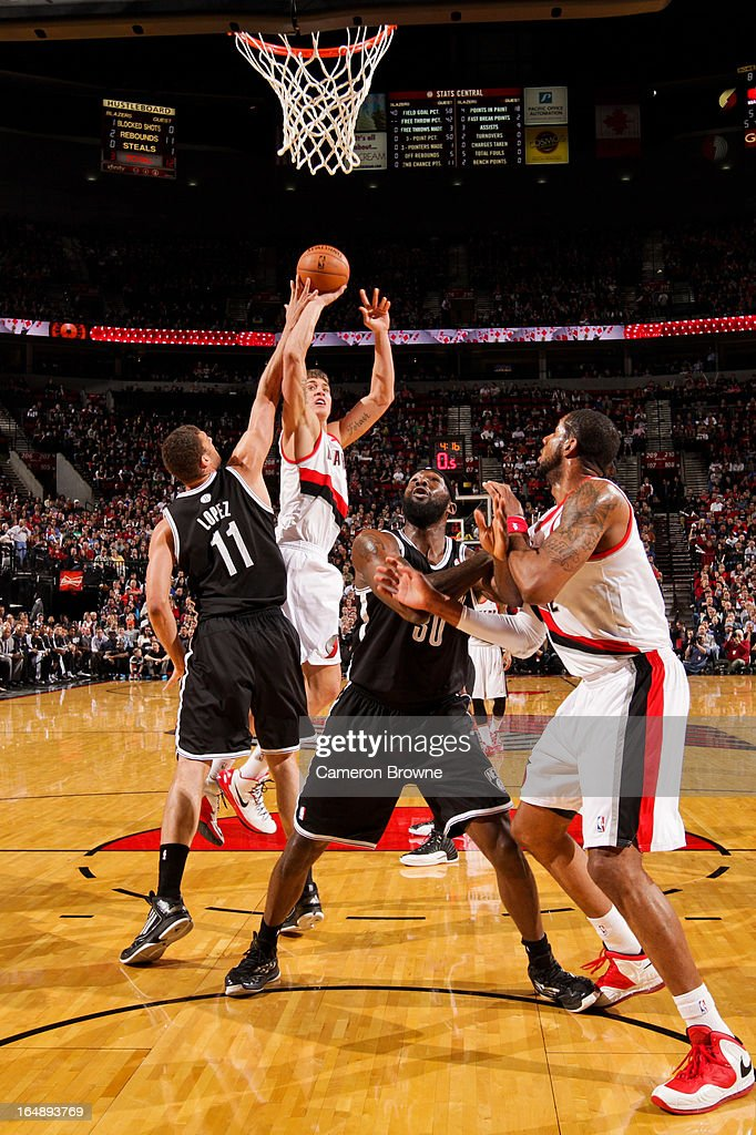 <a gi-track='captionPersonalityLinkClicked' href=/galleries/search?phrase=Meyers+Leonard&family=editorial&specificpeople=6893999 ng-click='$event.stopPropagation()'>Meyers Leonard</a> #11 of the Portland Trail Blazers shoots in the lane against <a gi-track='captionPersonalityLinkClicked' href=/galleries/search?phrase=Brook+Lopez&family=editorial&specificpeople=3847328 ng-click='$event.stopPropagation()'>Brook Lopez</a> #11 of the Brooklyn Nets on March 27, 2013 at the Rose Garden Arena in Portland, Oregon.