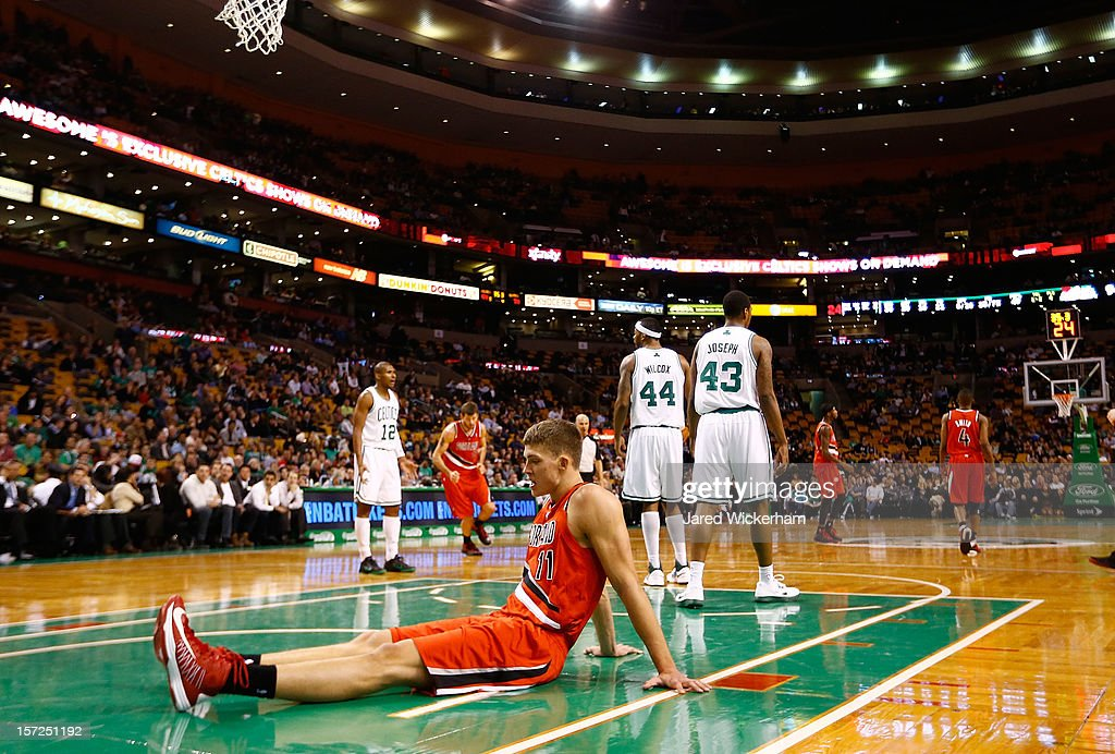 Meyers Leonard #11 of the Portland Trail Blazers sits on the court after he fell failing to make a basket against the Boston Celtics during the game on November 30, 2012 at TD Garden in Boston, Massachusetts.