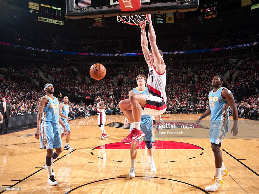 <a gi-track='captionPersonalityLinkClicked' href=/galleries/search?phrase=Meyers+Leonard&family=editorial&specificpeople=6893999 ng-click='$event.stopPropagation()'>Meyers Leonard</a> #11 of the Portland Trailblazers dunks the ball against the Denver Nuggets on December 20, 2012 at the Rose Garden Arena in Portland, Oregon.
