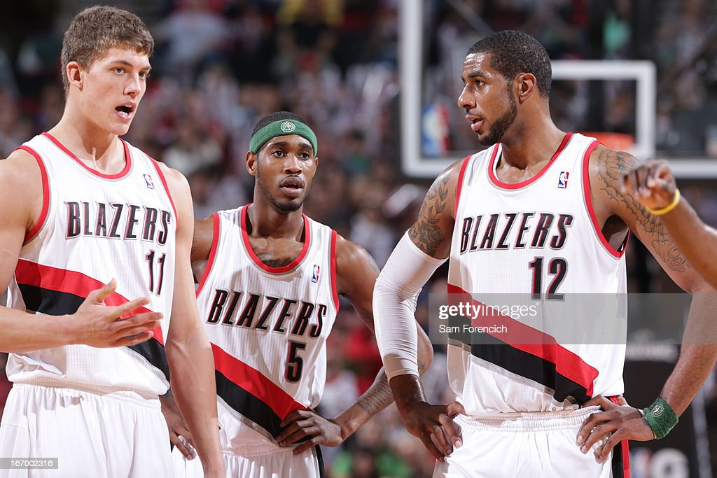 <a gi-track='captionPersonalityLinkClicked' href=/galleries/search?phrase=Meyers+Leonard&family=editorial&specificpeople=6893999 ng-click='$event.stopPropagation()'>Meyers Leonard</a> #11, <a gi-track='captionPersonalityLinkClicked' href=/galleries/search?phrase=Will+Barton&family=editorial&specificpeople=6894020 ng-click='$event.stopPropagation()'>Will Barton</a> #5 and <a gi-track='captionPersonalityLinkClicked' href=/galleries/search?phrase=LaMarcus+Aldridge&family=editorial&specificpeople=453277 ng-click='$event.stopPropagation()'>LaMarcus Aldridge</a> #12 of the Portland Trail Blazers stand on the court during the game against the Houston Rockets on April 5, 2013 at the Rose Garden Arena in Portland, Oregon.