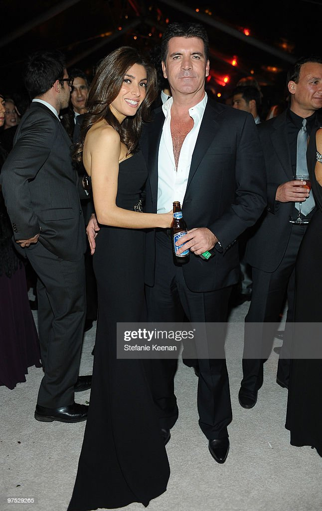 Mezhgan Hussainy and TV personality Simon Cowell attend the 18th Annual Elton John AIDS Foundation Oscar Party at Pacific Design Center on March 7, 2010 in West Hollywood, California.