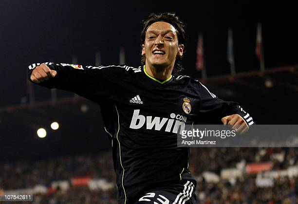 Mezut Ozil of Real Madrid celebrates after scoring Real's opening goal during the La Liga match between Real Zaragoza and Real Madrid at La Romareda...