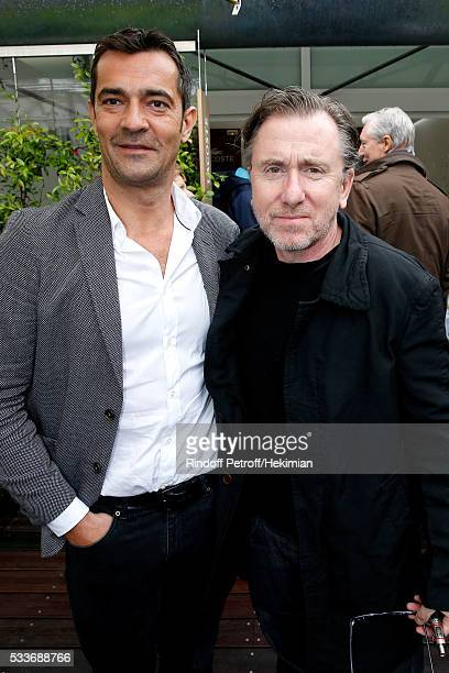 CEO MFI/Lacoste Thierry Guibert and Actor Tim Roth attend the 2016 French Tennis Open Day Two at Roland Garros on May 23 2016 in Paris France