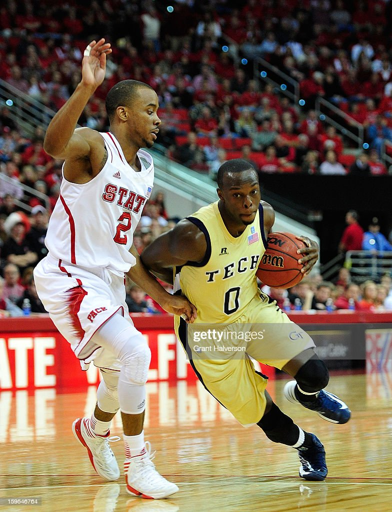 Mfon Udofi #0 of the Georgia Tech Yellow Jackets drives against Lorenzo Brown #2 of the North Carolina State Wolfpack at PNC Arena on January 9, 2013 in Raleigh, North Carolina. North Carolina State won 83-70.