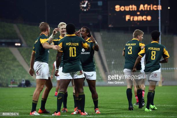 Mfundo Ndhlovu of South Africa celebrates with team mates after scoring a try during the match between South Africa and France on Day 1 of the Rugby...