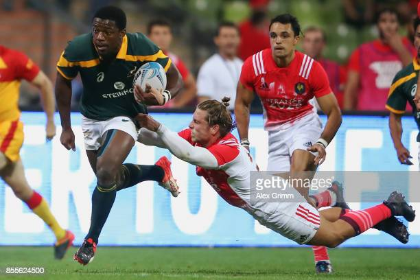 Mfundo Ndhlovu of South Africa eludes Stephen Parez of France during the match between South Africa and France on Day 1 of the Rugby Oktoberfest 7s...