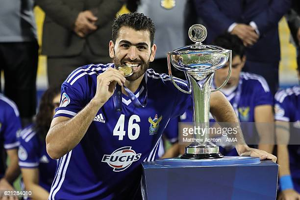 Mhd Zaher Almedani of AlQuwa AlJawiya of Iraq celebrates with his medal and the trophy after the AFC Cup Final match between JSW Bengaluru and Air...