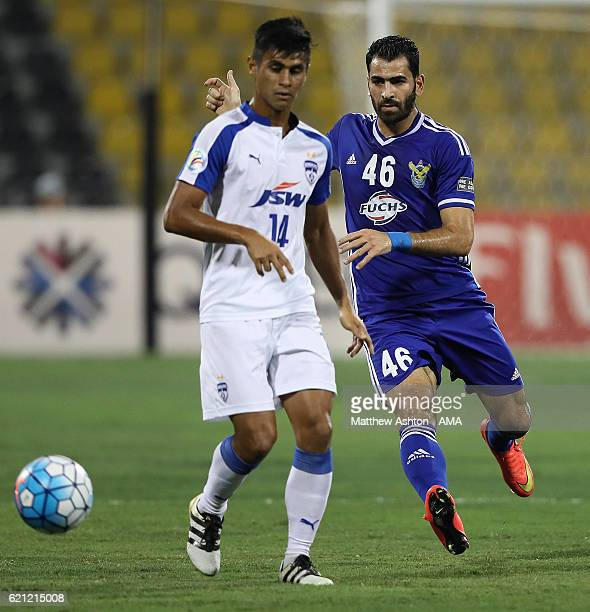 Mhd Zaher Almedani of AlQuwa AlJawiya of Iraq competes with Eugeneson Lyngdoh of Bengaluru FC of India during the AFC Cup Final match between JSW...