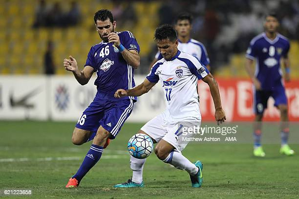 Mhd Zaher Almedani of AlQuwa AlJawiya of Iraq competes with Seminlen Doungel of Bengaluru FC of India during the AFC Cup Final match between JSW...