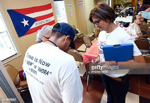 'Mi Famila Vota' representative Jose Castellanos and Naloy Zapata register people to vote during a Hispanic Heritage Celebration breakfast at the...