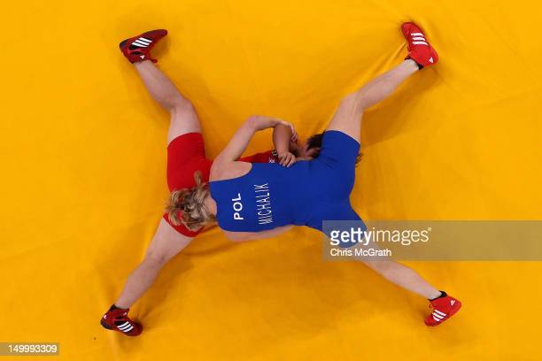 Mi Gyong Choe of DPR Korea competes against Monika Ewa Michalik of Poland during their Women's Freestyle 63 kg Wrestling match on Day 12 of the...