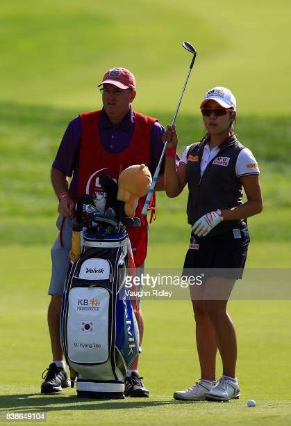 Mi Hyang Lee of Korea pulls a club from her bag on the third hole during round one of the Canadian Pacific Women's Open at the Ottawa Hunt Golf Club...