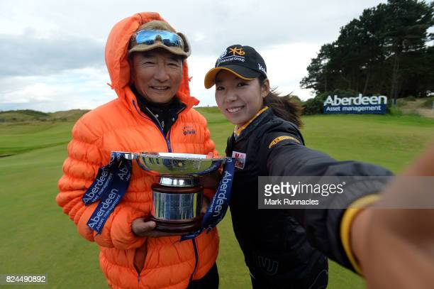 Mi Hyang Lee of Korea winner of the Aberdeen Asset Management Ladies Scottish Open takes a selfie with her father as she lifts the trophy after the...
