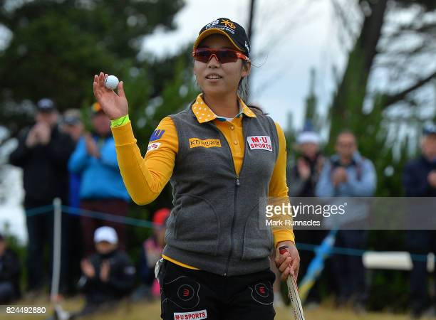 Mi Hyang Lee of Korea winner of the Aberdeen Asset Management Ladies Scottish Open waves to the crowd at the 18th green as she finishes her final...