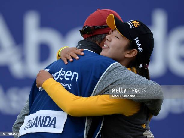 Mi Hyang Lee of Korea winner of the Aberdeen Asset Management Ladies Scottish Open is congratulated at the 18th green by Carlota Ciganda of Spain...