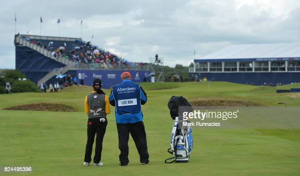 Mi Hyang Lee of Korea winner of the Aberdeen Asset Management Ladies Scottish Open waits to play her second shot at the 18th hole as she finishes her...
