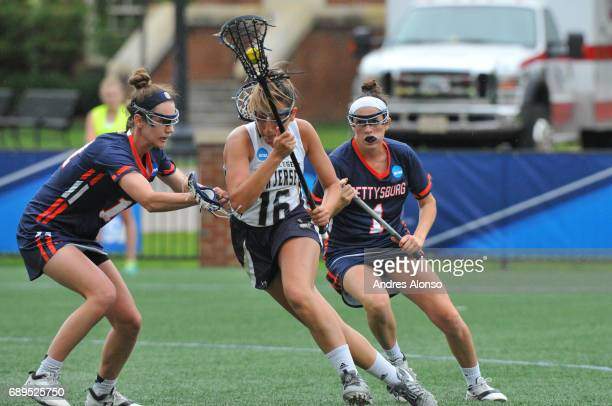Mia Blackman of College of New Jersey drives to the goal defended by Gettysburg College players during the Division III Women's Lacrosse Championship...