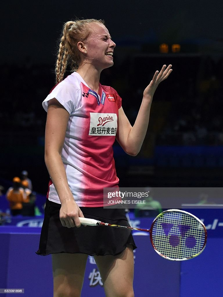 Mia Blichfeld of Denmark reacts after missing a return against Sun