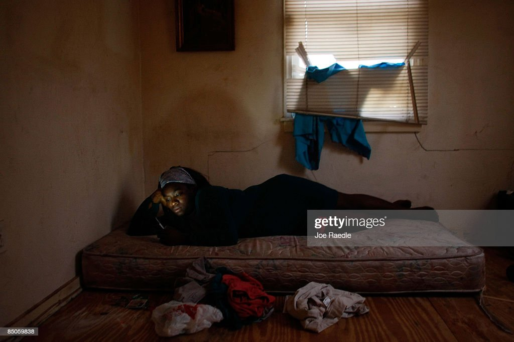 Mia Dennis lays on a mattress in her former bedroom in the foreclosed home that she and her family reoccupied after busting the locks and moving in with the help of the activist group 'Take Back the Land' February 24, 2009 in Miami, Florida. The family was evicted from the home and had been living in a van in the parking lot of a local supermarket since Friday when they were evicted. Mary Trody, her husband and her two children were living in the house and could not pay their bills due to what she says was predatory lending by a mortgage company. Her husband lost his job, which forced the couple and their two teenage children along with other relatives to move back in to the house before they lost it to foreclosure and now the bank owns the house.