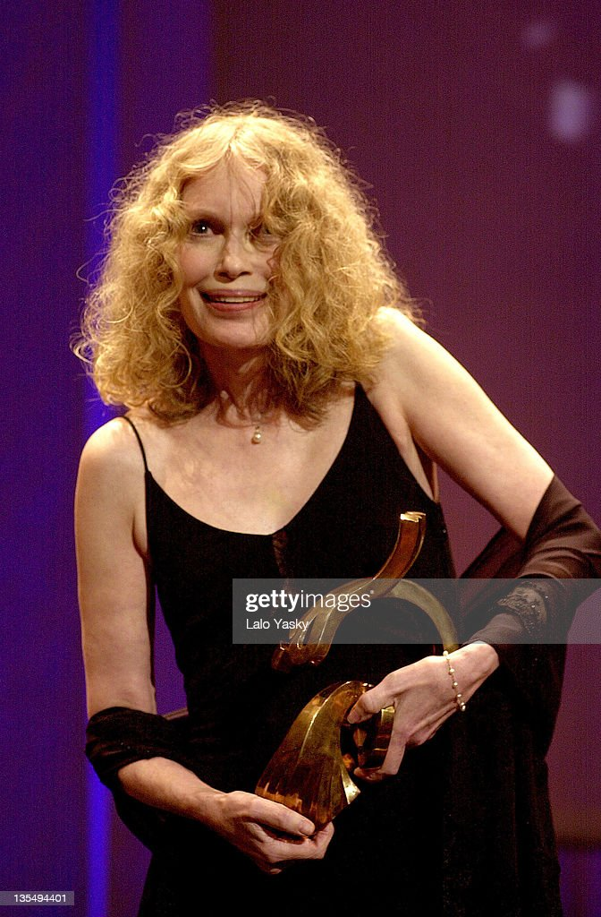 <a gi-track='captionPersonalityLinkClicked' href=/galleries/search?phrase=Mia+Farrow&family=editorial&specificpeople=93764 ng-click='$event.stopPropagation()'>Mia Farrow</a> Receives the Honorary Award during 2004 Las Palmas Film Festival at Alfredo Kraus Audiotrium in Las Palmas, Canarias Islands, Spain.