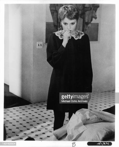 Mia Farrow with hand to mouth in a scene from the film 'John And Mary' 1969
