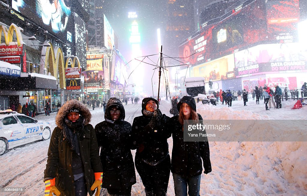 Mia Fraser Zakiya Cordice Tierra Sinclair and Raina Schoen Thomas walk through the snowy streets of Times Square as all cars but emergency vehicles...