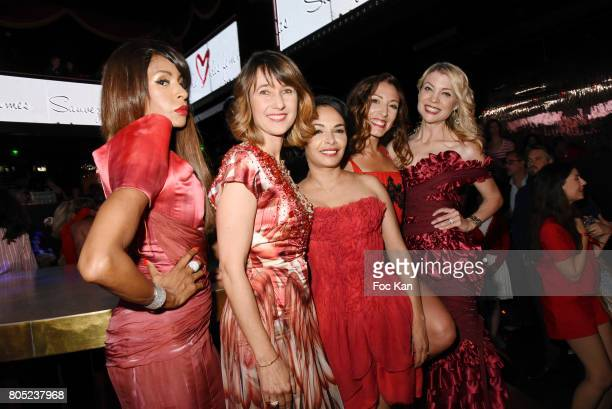 Mia Frye Alexia Laroche Joubert Saida Jawa Silvia Notargiacomo and Claire Verneil attend the 'Red Defile' Auction Fashion Show Hosted by Ajila...