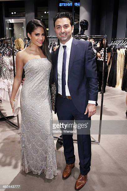 Mia Gray and Shahin Moghadam attend the Unique Flagship Store Opening at the new 'Koe Bogen' on November 28 2013 in Duesseldorf Germany