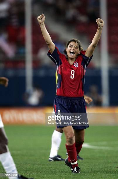 Mia Hamm of the United States celebrates after she and her team the Fab Five beat Brazil 21 in overtime for Olympic gold in women's soccer at the...