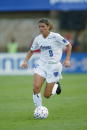 Mia Hamm of the Washington Freedom dribbles the ball during the WUSA Founders Cup II Championship game against the Carolina Courage on August 24 2002...