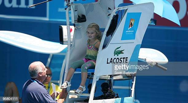 Mia Hewitt sits in the umpires chair as she watches her father Lleyton Hewitt of Australia during a practice session ahead of the 2010 Australian...