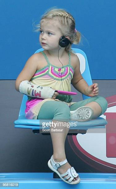 Mia Hewitt watches her father Lleyton Hewitt of Australia during a practice session ahead of the 2010 Australian Open at Melbourne Park on January 16...