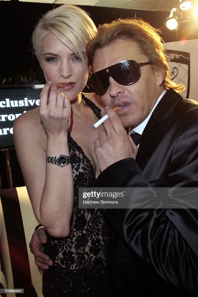 Mia Landre and Smoking Everywhere Co-Owner Ferdinand Bare with Smoking Everywhere electronic cigarettes at the Smoking Everywhere booth backstage at the NAACP Image Awards at the Shrine Auditorium on February 12, 2009 in Los Angeles, California.