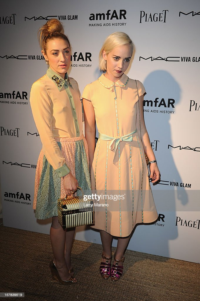 Mia Moretti and Caitlin Moe attend the amfAR Inspiration Miami Beach Party at Soho Beach House on December 6, 2012 in Miami Beach, Florida.