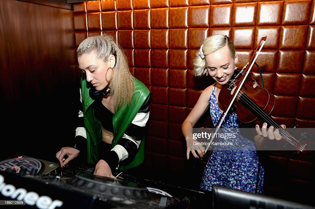 DJ Mia Moretti (L) and violinist Caitlin Moe perform at Ashley Hebert and J.P. Rosenbaum Celebrate Brancott Estate Chill Houron at Catch Roof on May 21, 2013 in New York City.