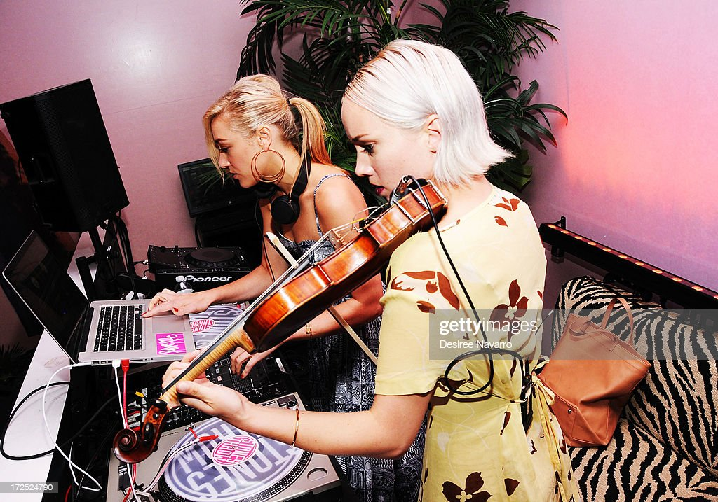 DJ Mia Moretti (L) and violinist Caitlin Moe perform at Indeed Laboratories official U.S. launch party at No. 8 Nightclub (New York, NY). New York City's beauty elite were in attendance as hot, new, global skin care brand announces U.S. debut at Walgreens nationwide on June 27, 2013 in New York City.