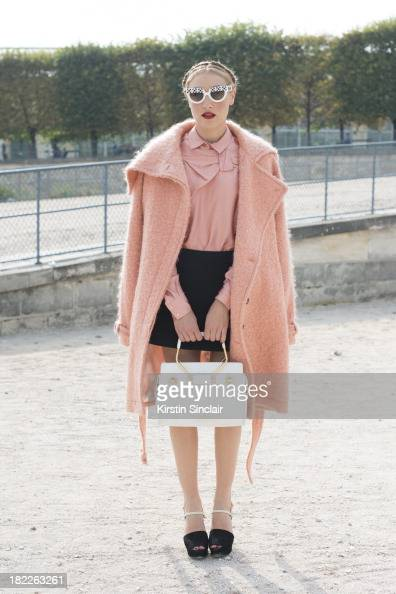 Mia Moretti wears all Viktor and Rolf with Osklen shoes and Prada sunglasses on day 5 of Paris Fashion Week Spring/Summer 2014 Paris September 28...