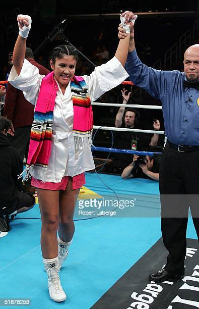 Mia St John celebrates defeating Janae Romero Archuleta by TKO in the first round in the bout on December 18 2004 at Staples Center in Los Angeles...