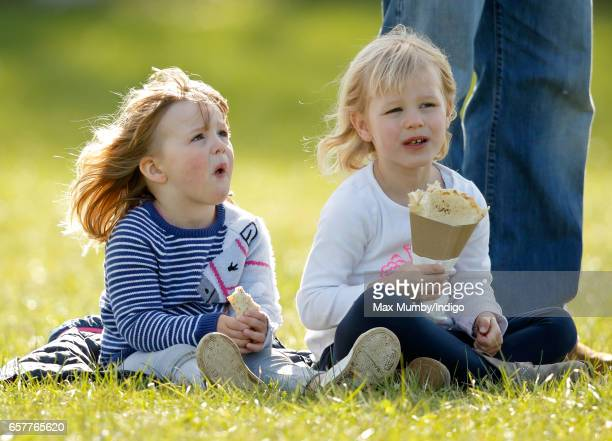 Mia Tindall and cousin Isla Phillips eat crepes as they attend the Gatcombe Horse Trials at Gatcombe Park on March 25 2017 in Stroud England