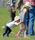 Mia Tindall and cousin Savannah Phillips lark about as they attend the Badminton Horse Trials on May 8 2016 in Badminton England