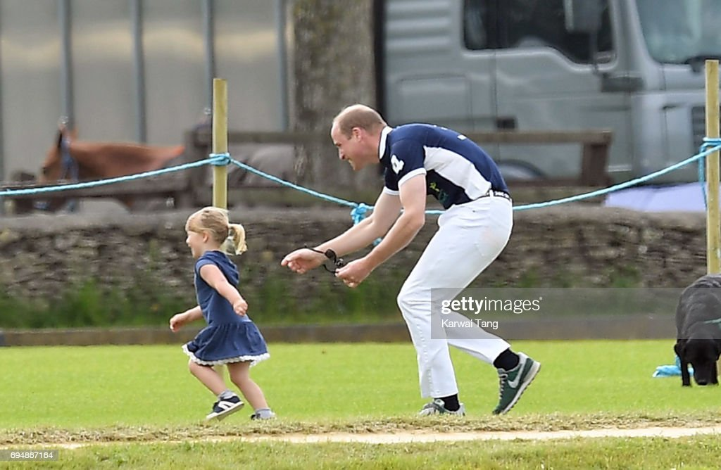 Mia Tindall gets chased by Prince William, Duke of Cambridge at the Maserati Royal Charity Polo Trophy at Beaufort Polo Club on June 11, 2017 in Tetbury, England.