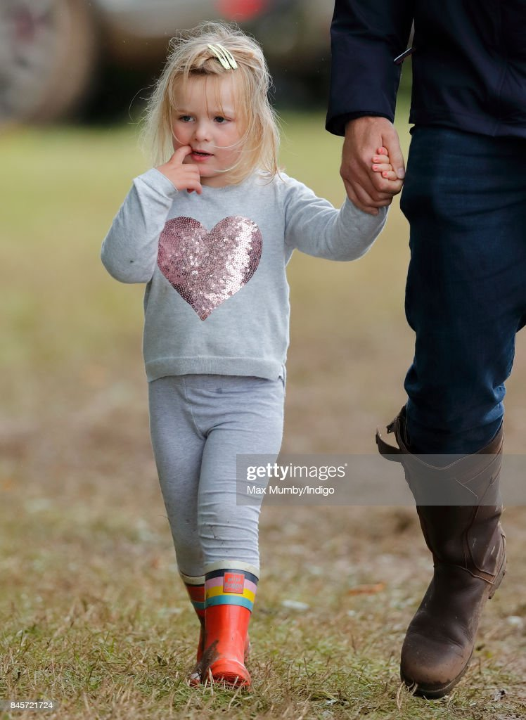 Mia Tindall holds hands with her father Mike Tindall as they attend day 3 of the Whatley Manor Horse Trials at Gatcombe Park on September 10, 2017 in Stroud, England.