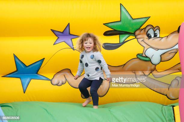 Mia Tindall plays on an inflatable bouncy slide as she attends the Burnham Market Horse Trials on April 14 2017 in Burnham Market England