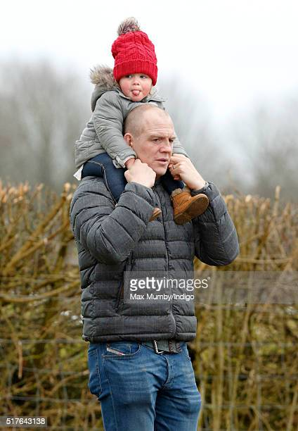 Mia Tindall pokes out her tongue as she rides on her father Mike Tindall's shoulders as they attend the Gatcombe Horse Trails at Gatcombe Park...