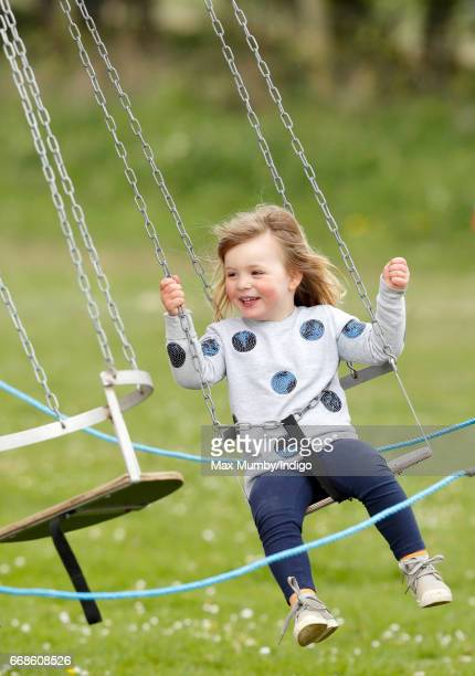 Mia Tindall rides on a funfair swing as she attends the Burnham Market Horse Trials on April 14 2017 in Burnham Market England