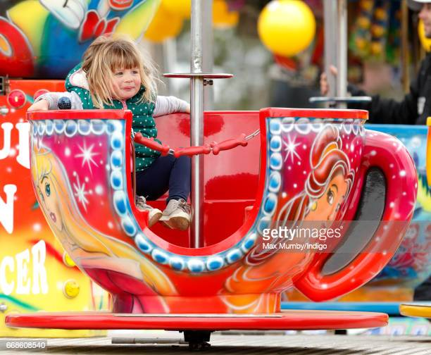 Mia Tindall spins on a cup and saucer ride as she attends the Burnham Market Horse Trials on April 14 2017 in Burnham Market England