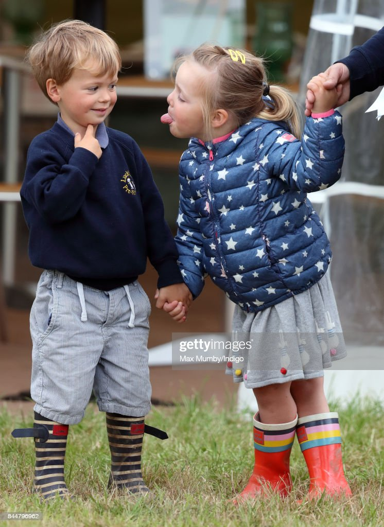 Mia Tindall sticks her tongue out at Charlie Meade (son of event rider Harry Meade) as they attend the Whatley Manor Horse Trials at Gatcombe Park on September 8, 2017 in Stroud, England.